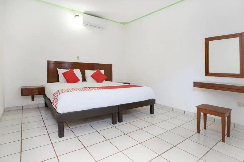 A bed or beds in a room at Hotel Nachancan