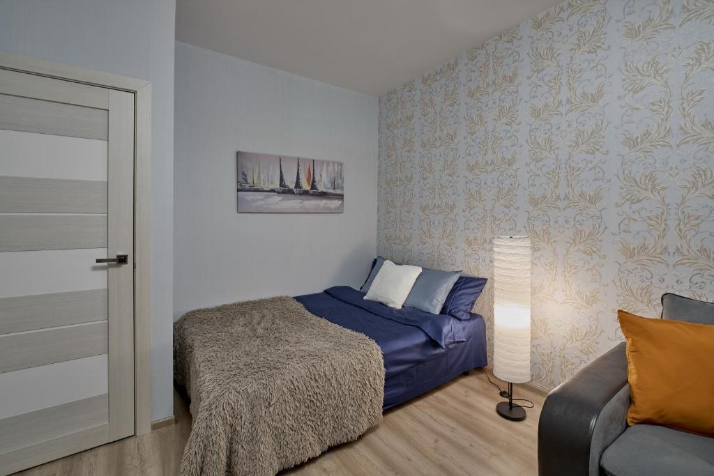 Кровать или кровати в номере Apartments Podlesnaya 43A
