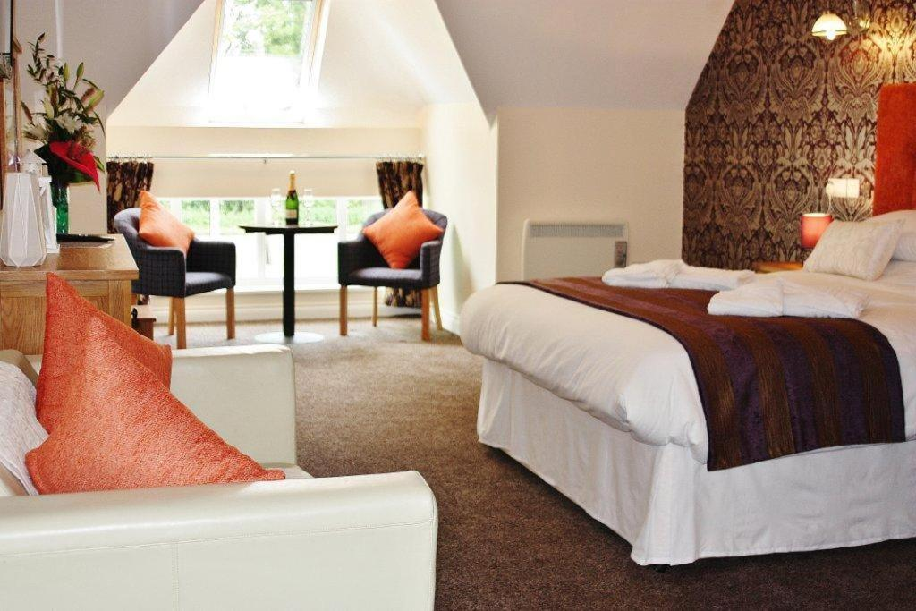 A bed or beds in a room at Hockley House