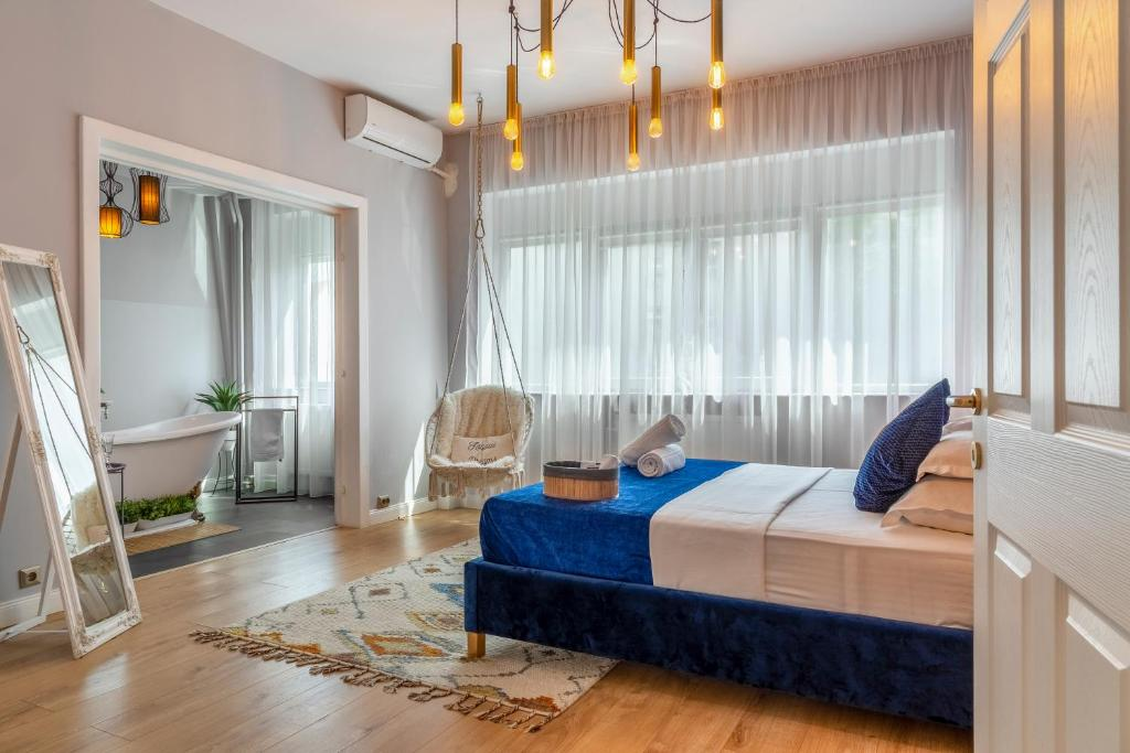 A bed or beds in a room at Intercontinental Apartment Downtown Bucharest