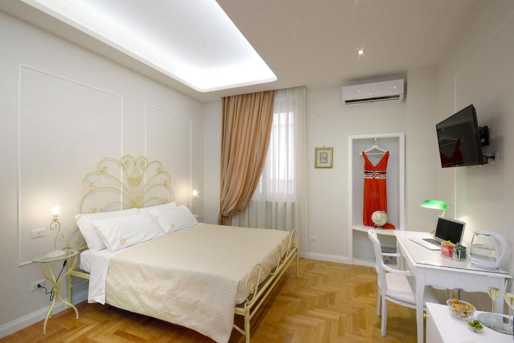 Letto o letti in una camera di Residenza Borbonica
