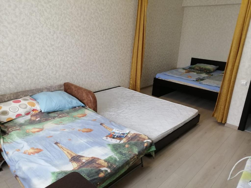 Кровать или кровати в номере ЛюксКвартира#13