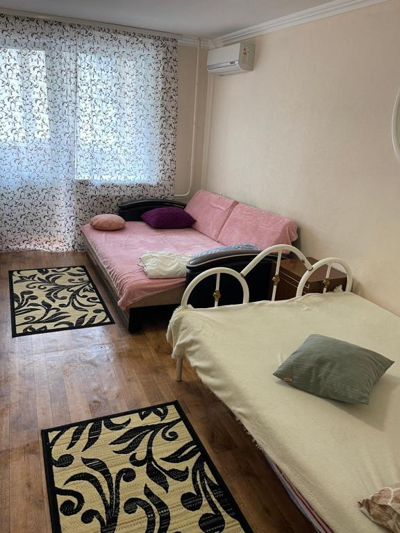 Кровать или кровати в номере Апартаменты Зорге - Благодатная