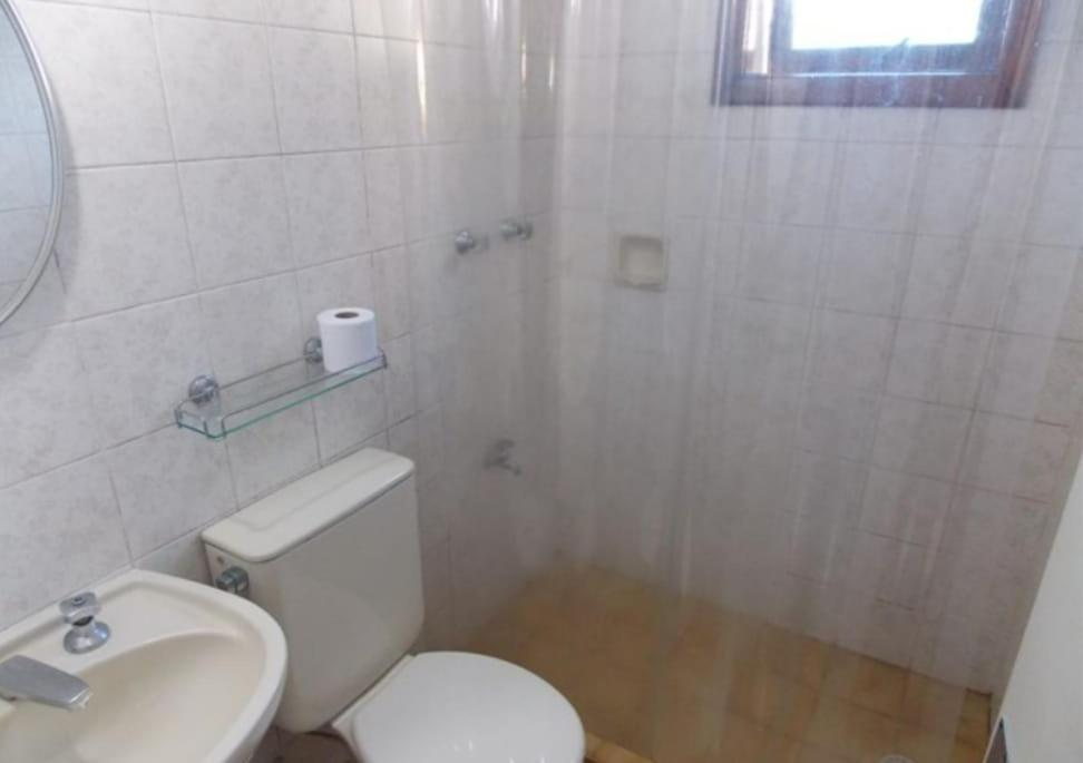 Um banheiro em HOTEL PORTO ALEGRE LTDA