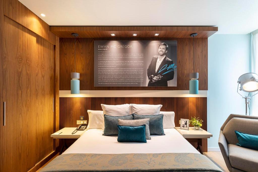 Cama o camas de una habitación en Hotel Zinema7
