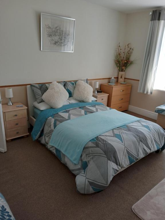 A bed or beds in a room at 16B Sandy Lane