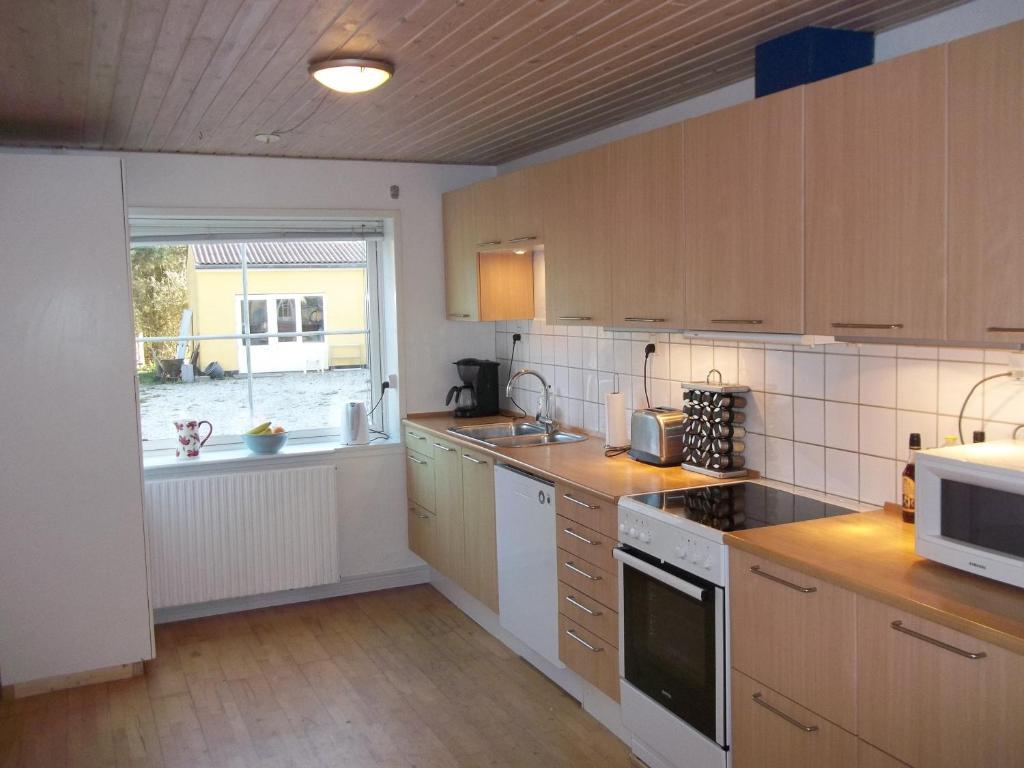 A kitchen or kitchenette at Børglum Mejeri Holiday Apartment