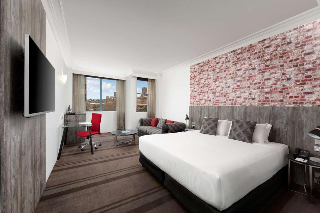 A bed or beds in a room at Rydges Sydney Central