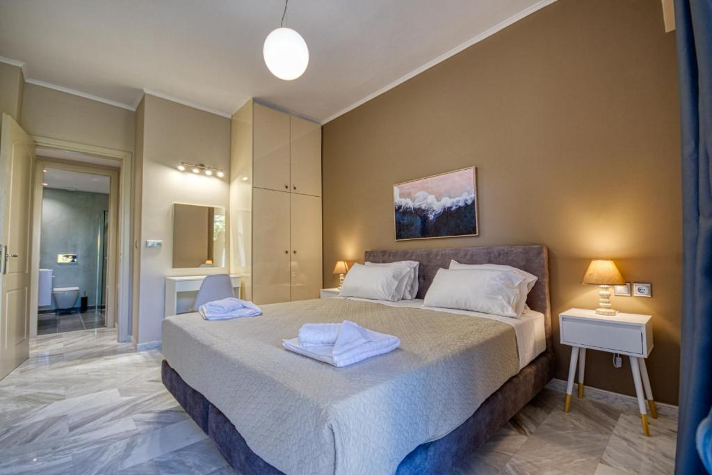 A bed or beds in a room at Island Boutique Hotel