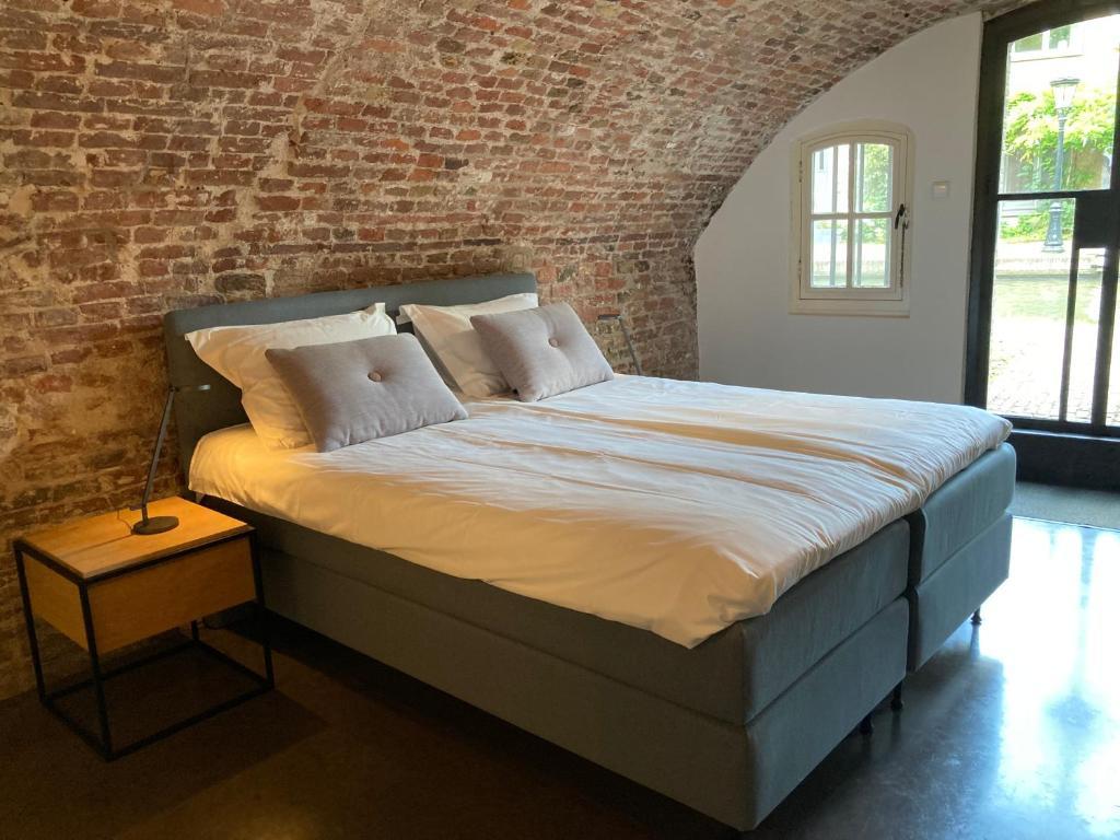A bed or beds in a room at De Hoendervorst