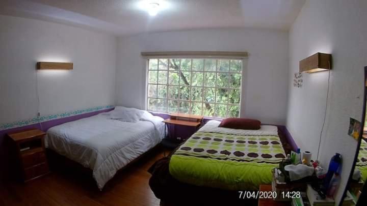 Cama o camas de una habitación en Departamento Camino Real