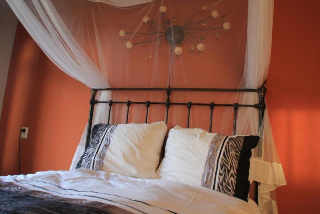 Een bed of bedden in een kamer bij Waard van Kekerdom