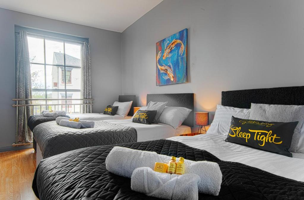 A bed or beds in a room at The Berwyn – Berwyn House
