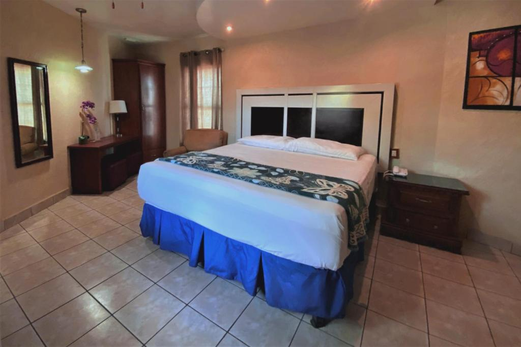 Cama o camas de una habitación en Hotel Hacienda del Viejo
