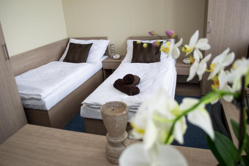 A bed or beds in a room at Penzion s wellness Uherské Hradiště