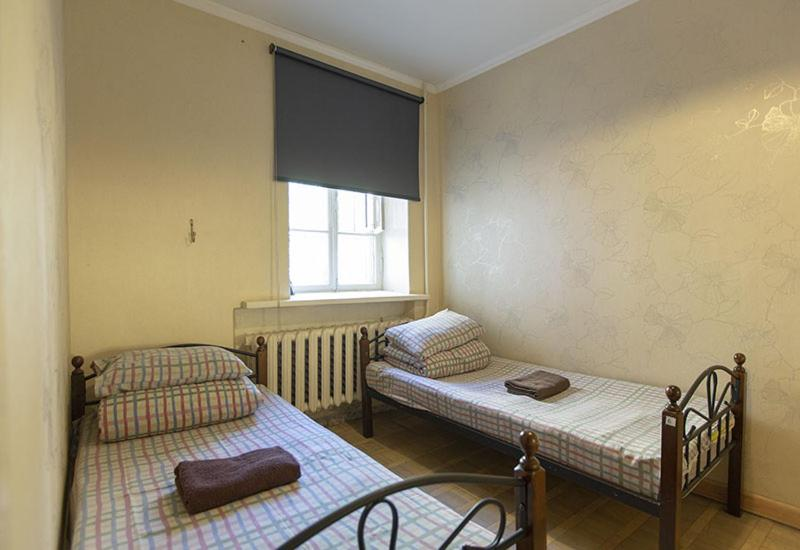 A bed or beds in a room at Riverside Hostel & Tours