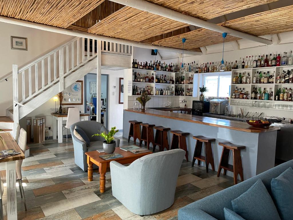 The lounge or bar area at BlueSky Arniston Guest House