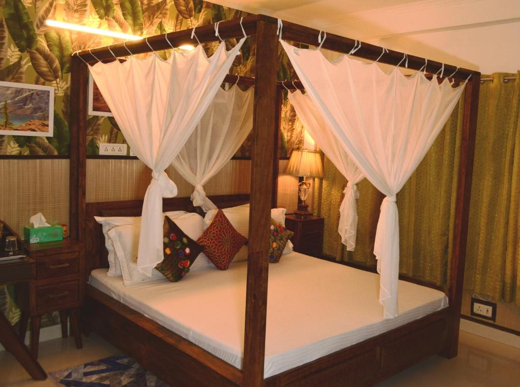 A bed or beds in a room at House of Comfort Noida