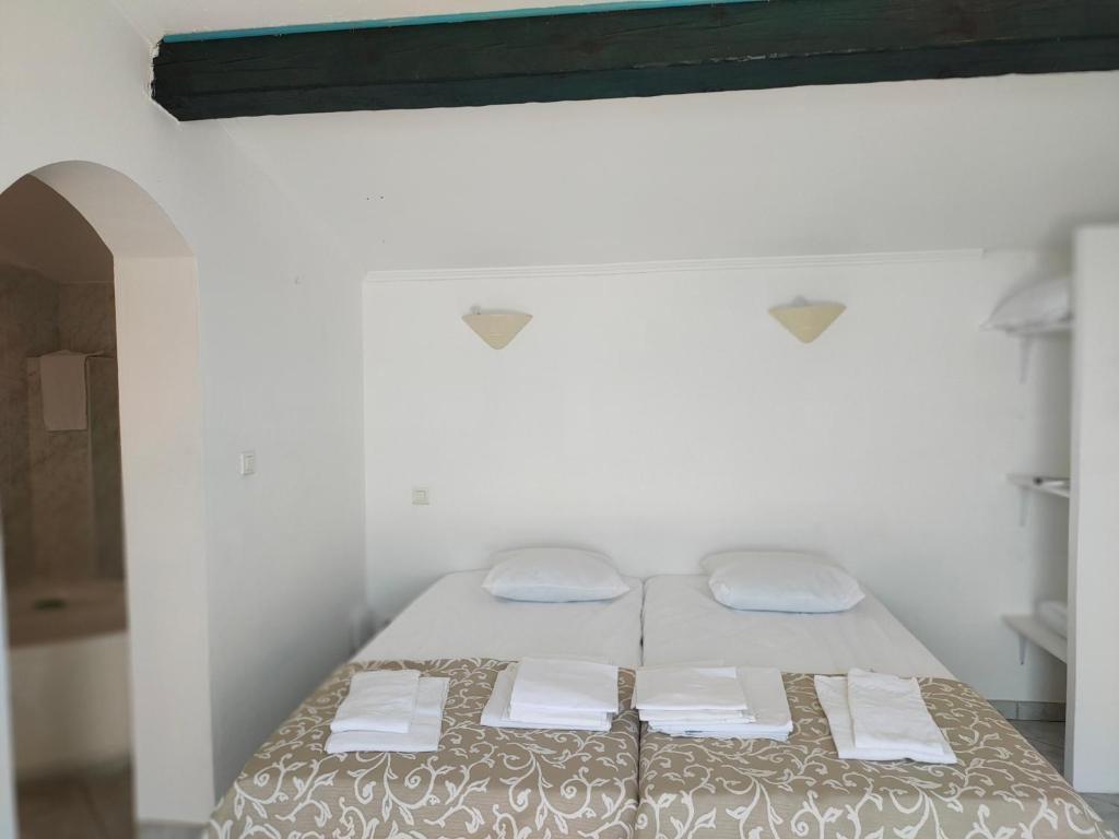 Ein Bett oder Betten in einem Zimmer der Unterkunft Résidence Les Pavillons du Golfe