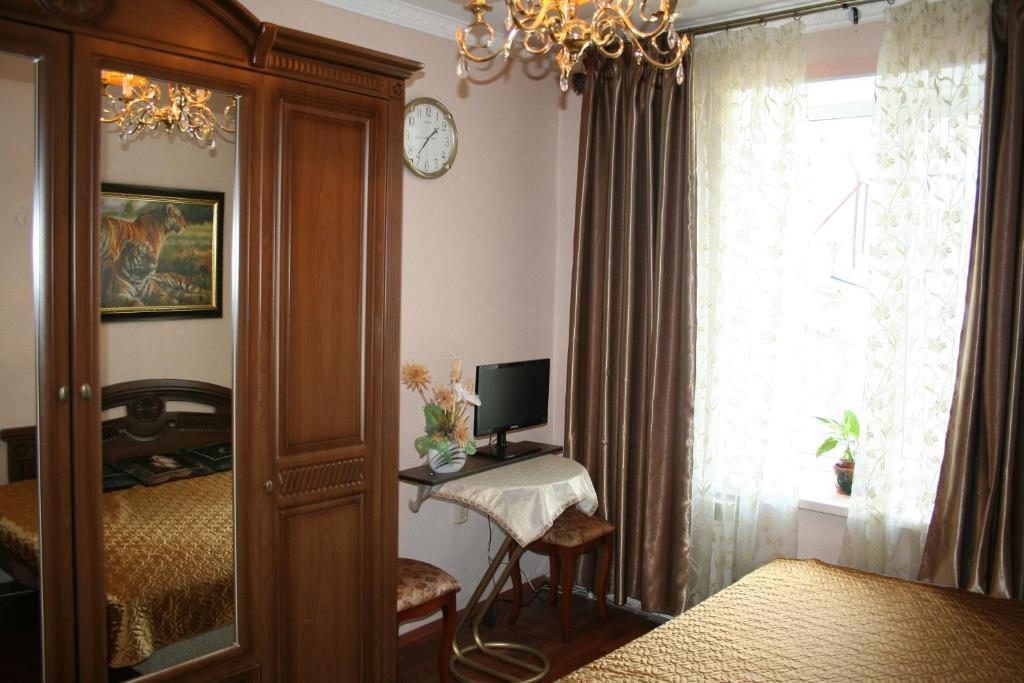 Телевизор и/или развлекательный центр в Guest House Griboedova 12