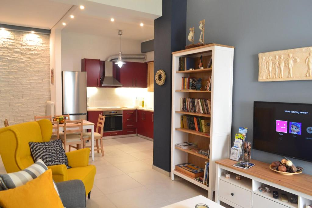 A television and/or entertainment centre at Central & Comfortable, 70m² Apt in Neos Kosmos