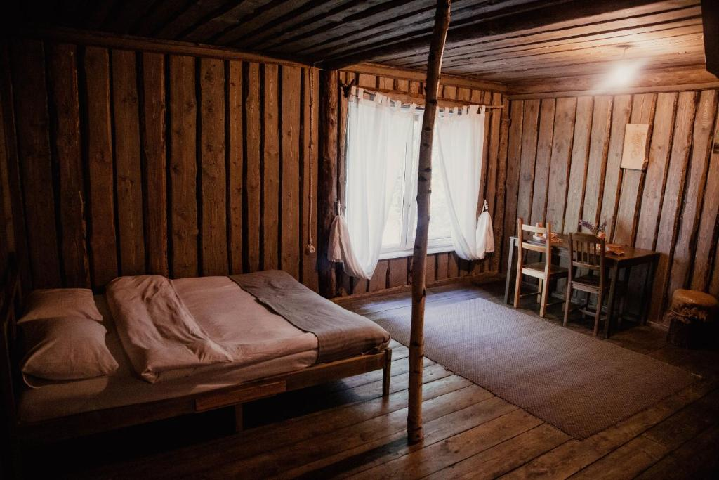 Кровать или кровати в номере Этно-Парк «Усадьба Рыбацкое»