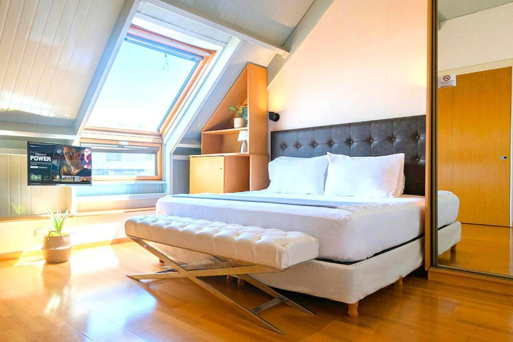 A bed or beds in a room at Modern&New Loft Puerto Madero