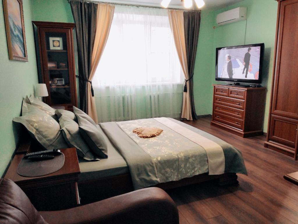 Кровать или кровати в номере Апартаменты на улице Красных Зорь