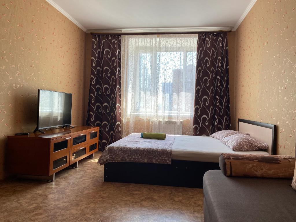 Кровать или кровати в номере Apartments at the Aqua Park Riviera