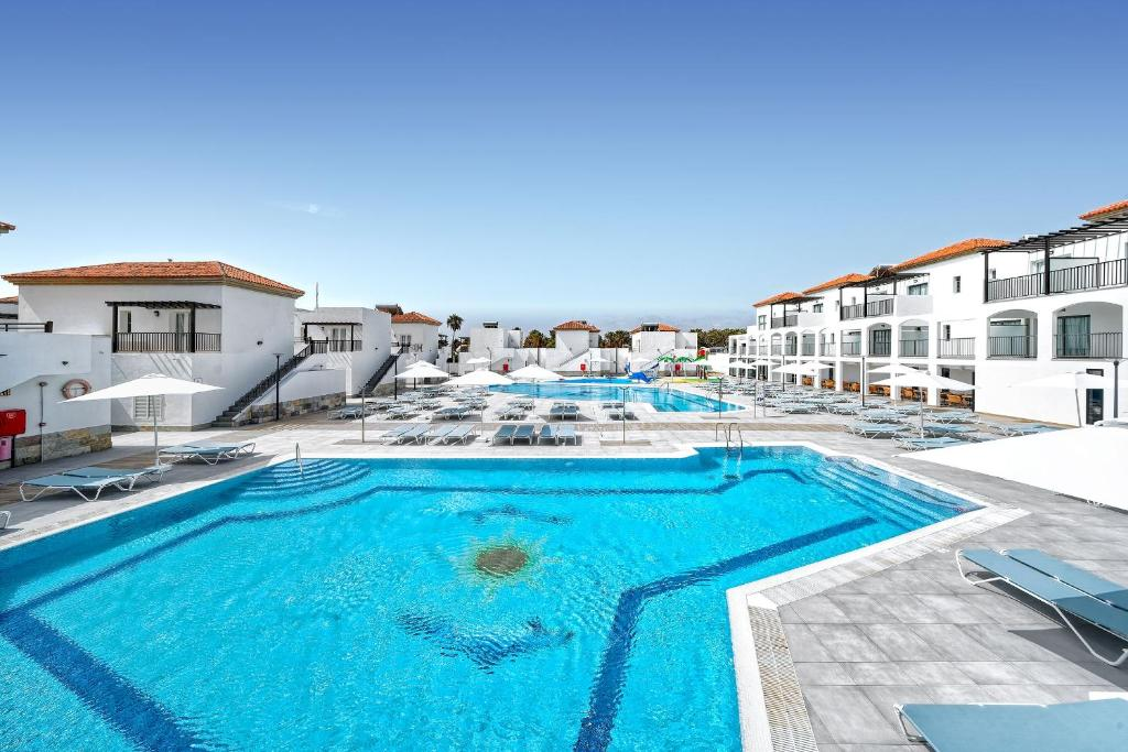 The swimming pool at or near Broncemar Beach Suites