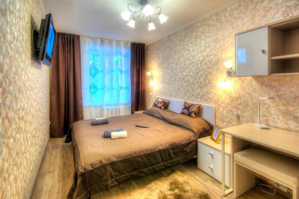 Кровать или кровати в номере Flat Inn Moscow Profsoyuznaya metro Quiet & Cozy Apartments