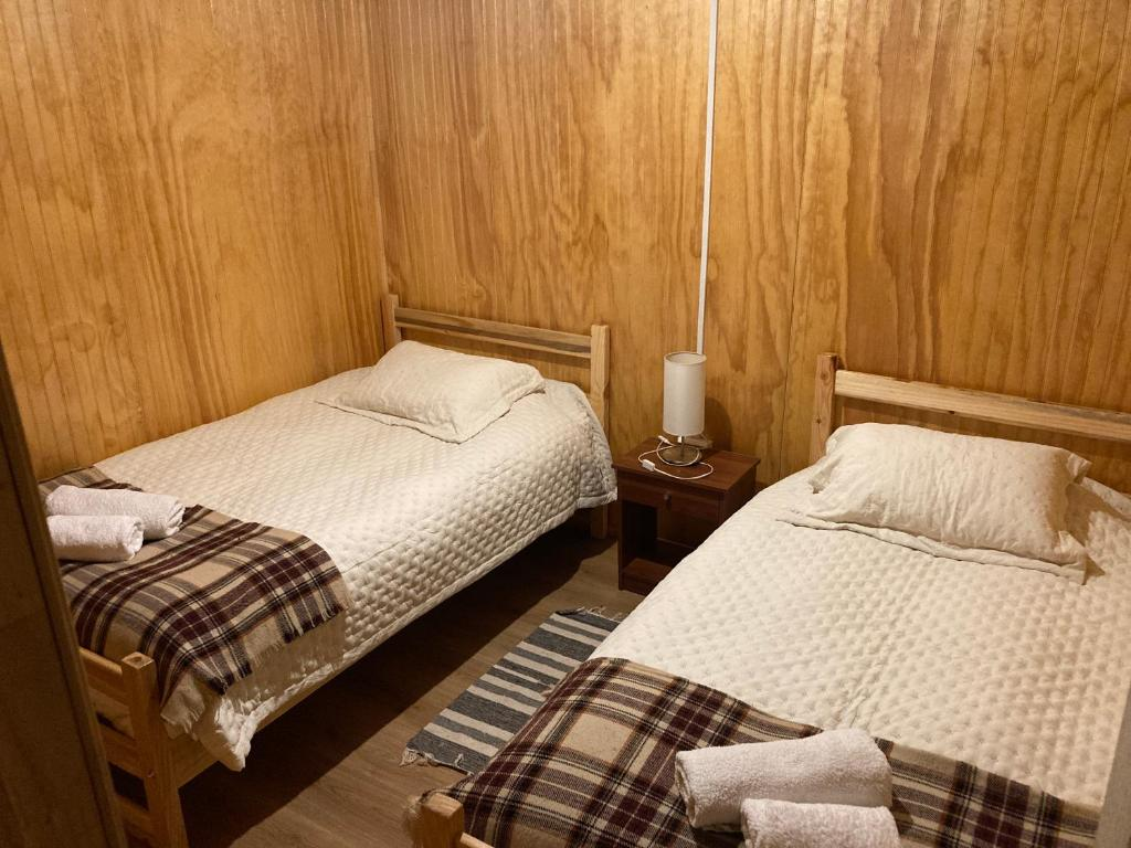 A bed or beds in a room at Puesto Cánogas Hostal
