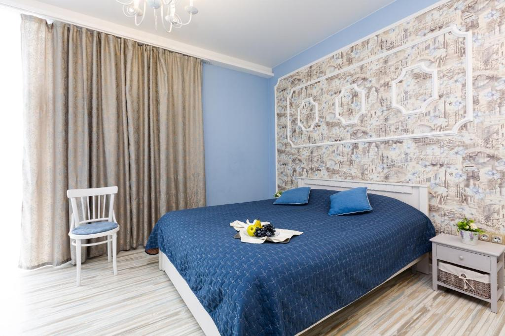 A bed or beds in a room at EtazhiDaily in Centre