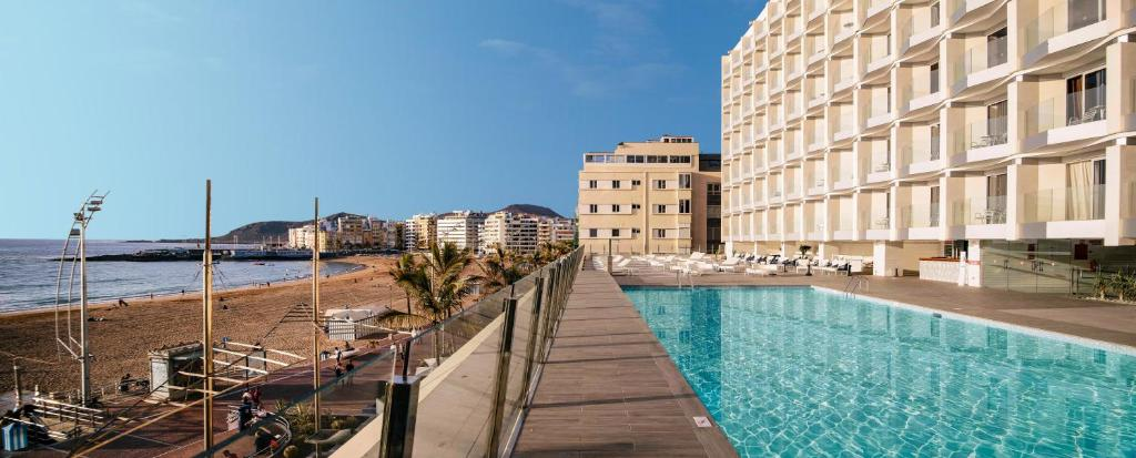 The swimming pool at or near Hotel Cristina by Tigotan Las Palmas