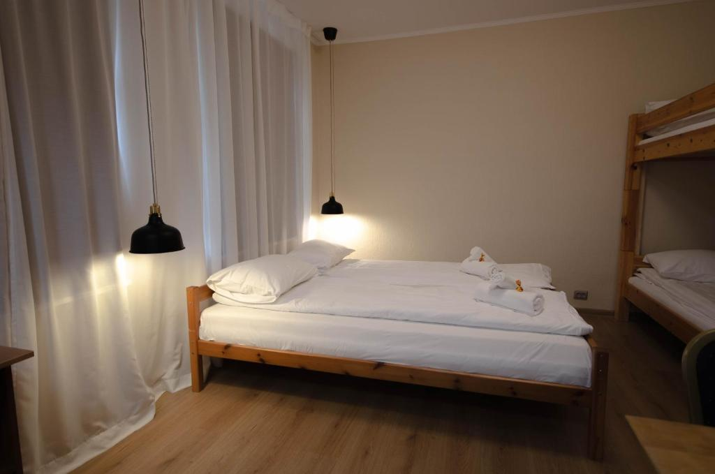 A bed or beds in a room at Olle