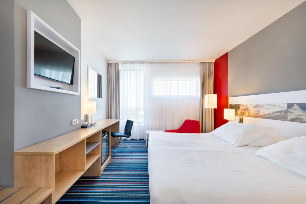 A bed or beds in a room at Holiday Inn Prague Airport, an IHG Hotel
