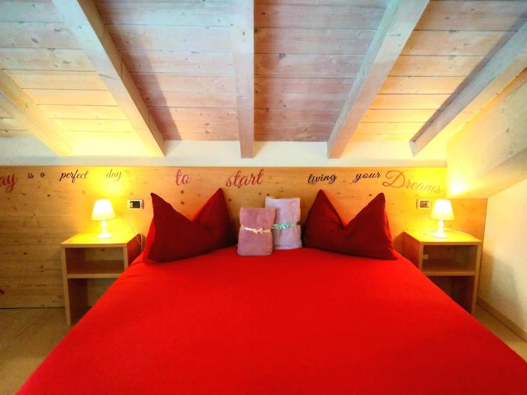 A bed or beds in a room at Camere Nordest Sudest