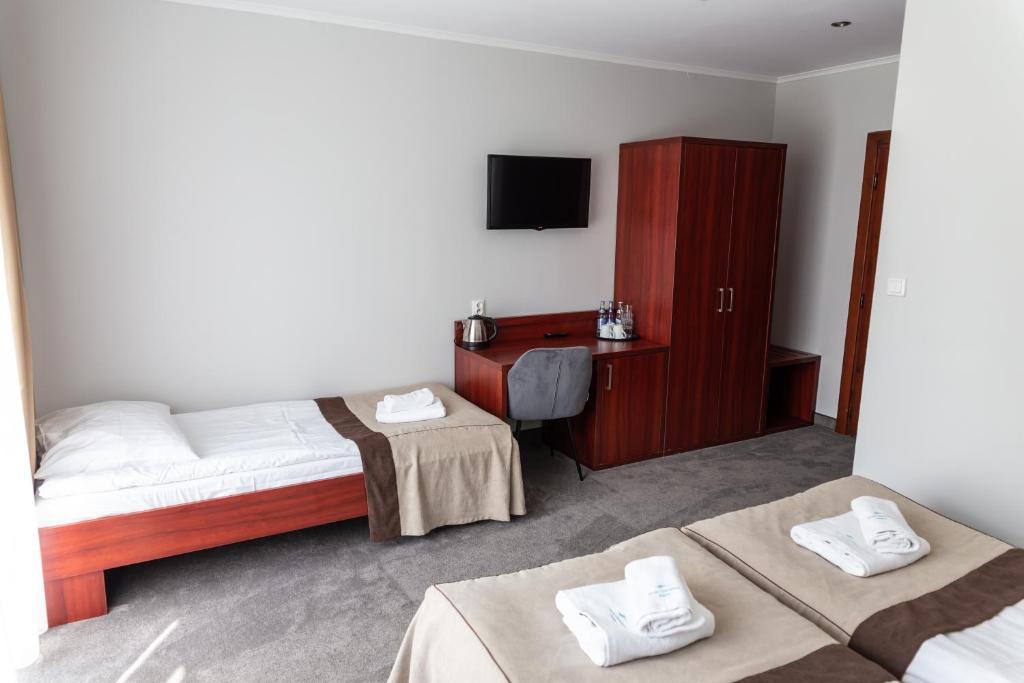 Łóżko lub łóżka w pokoju w obiekcie Ośrodek Wypoczynkowy POŁONINY