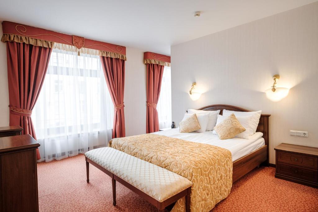 Кровать или кровати в номере Гостиница Смольнинская