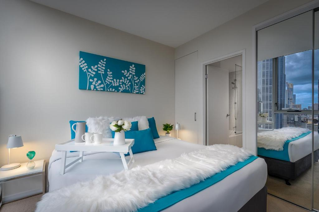 A bed or beds in a room at Milano Serviced Apartments