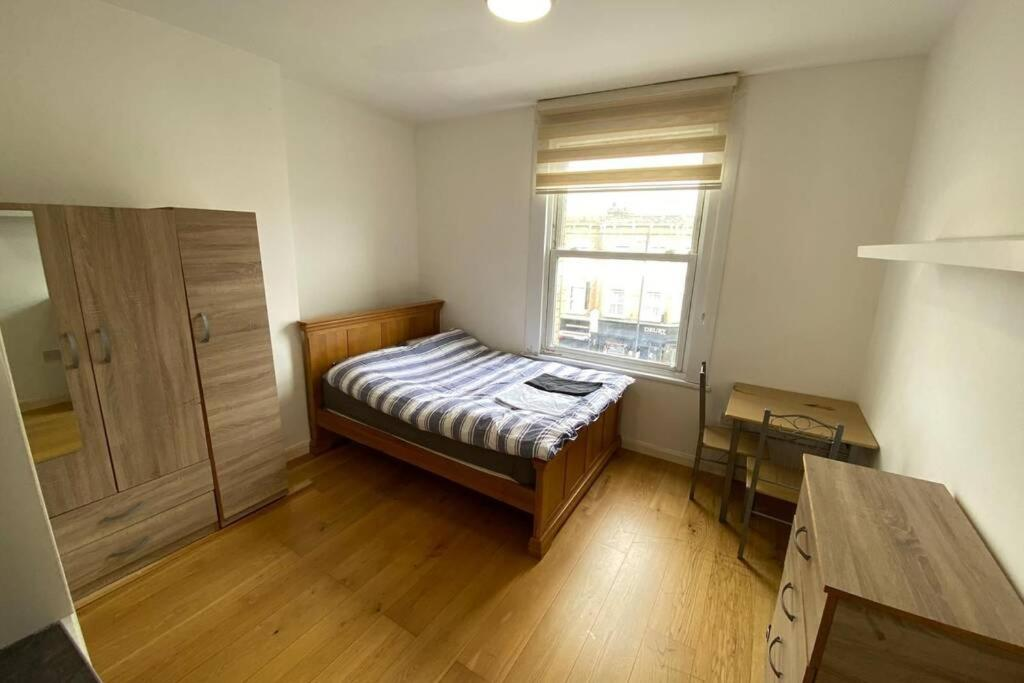 A bed or beds in a room at Stoke Newington Cozy Area Private Studio Flat