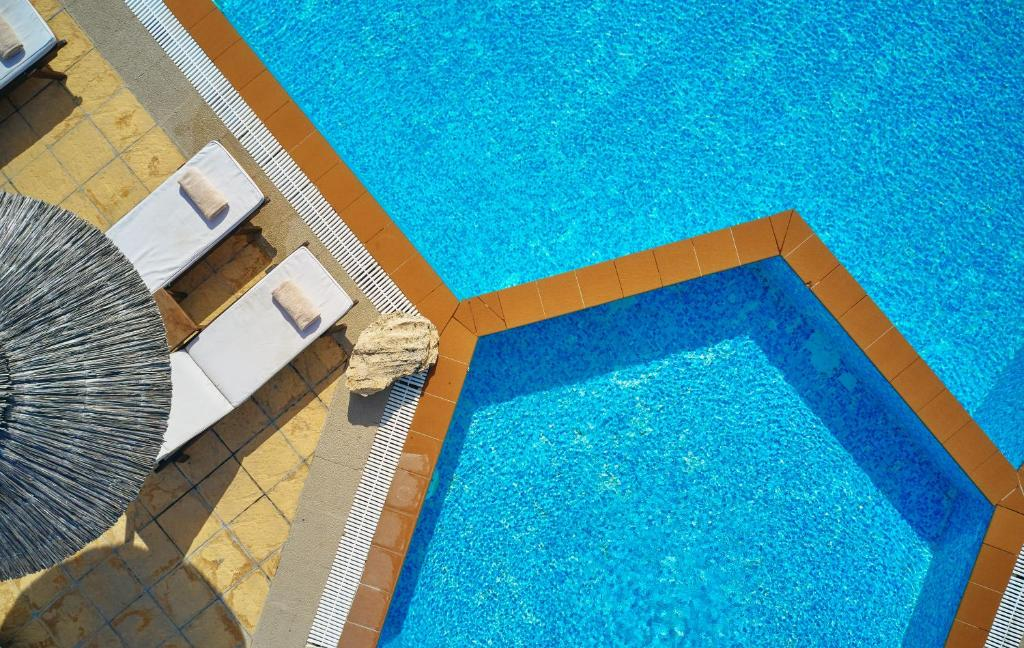 A view of the pool at Maison Hotel or nearby