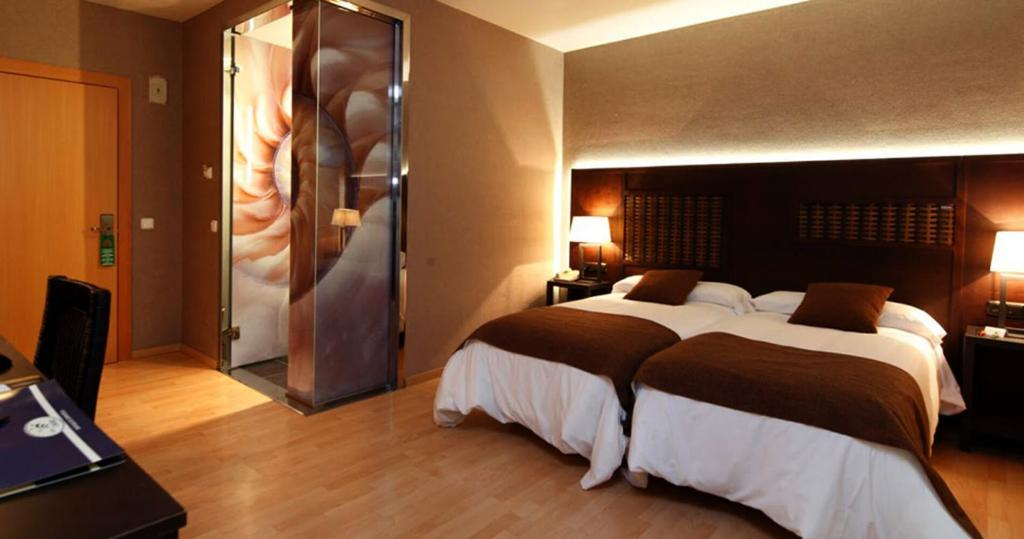 A bed or beds in a room at Pension Europa