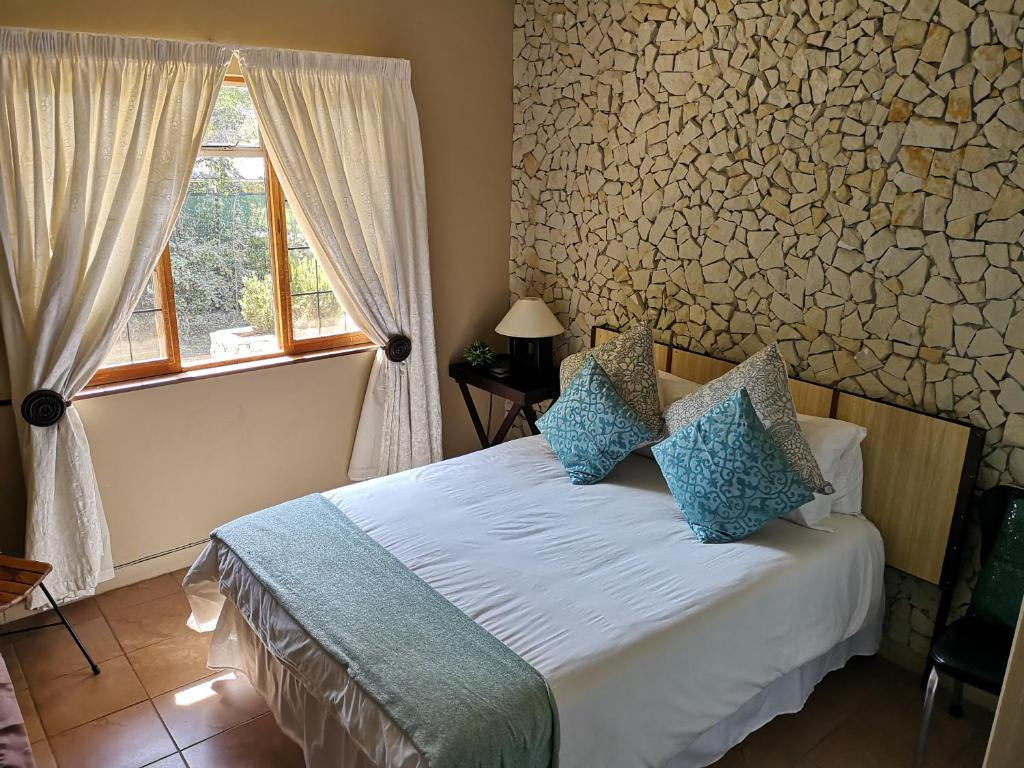 A bed or beds in a room at Abba Self Catering