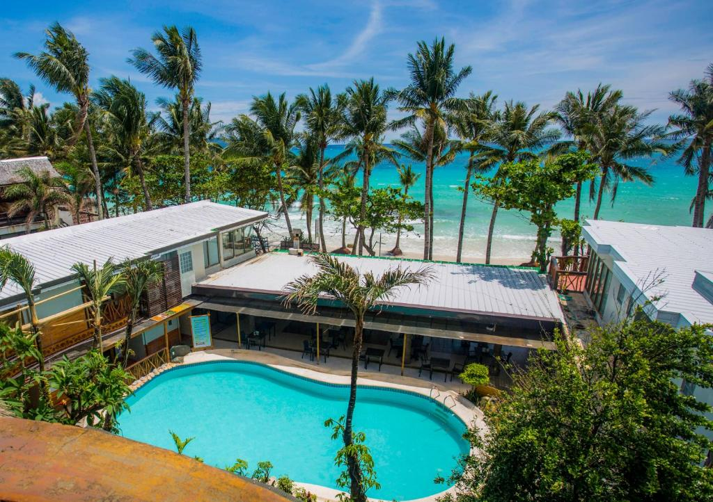 A view of the pool at Red Coconut Beach Hotel Boracay or nearby