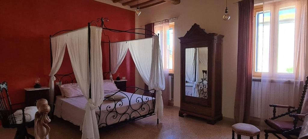 A bed or beds in a room at Il Nido del Cuculo