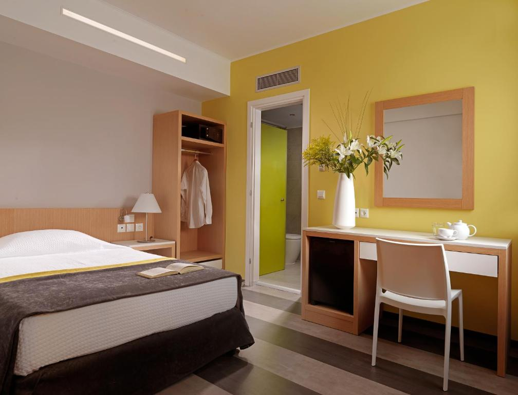 A bed or beds in a room at Airotel Galaxy