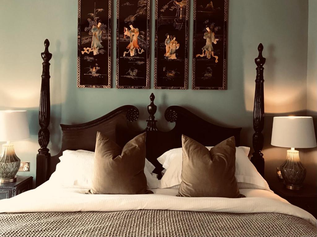 A bed or beds in a room at The Bridge House