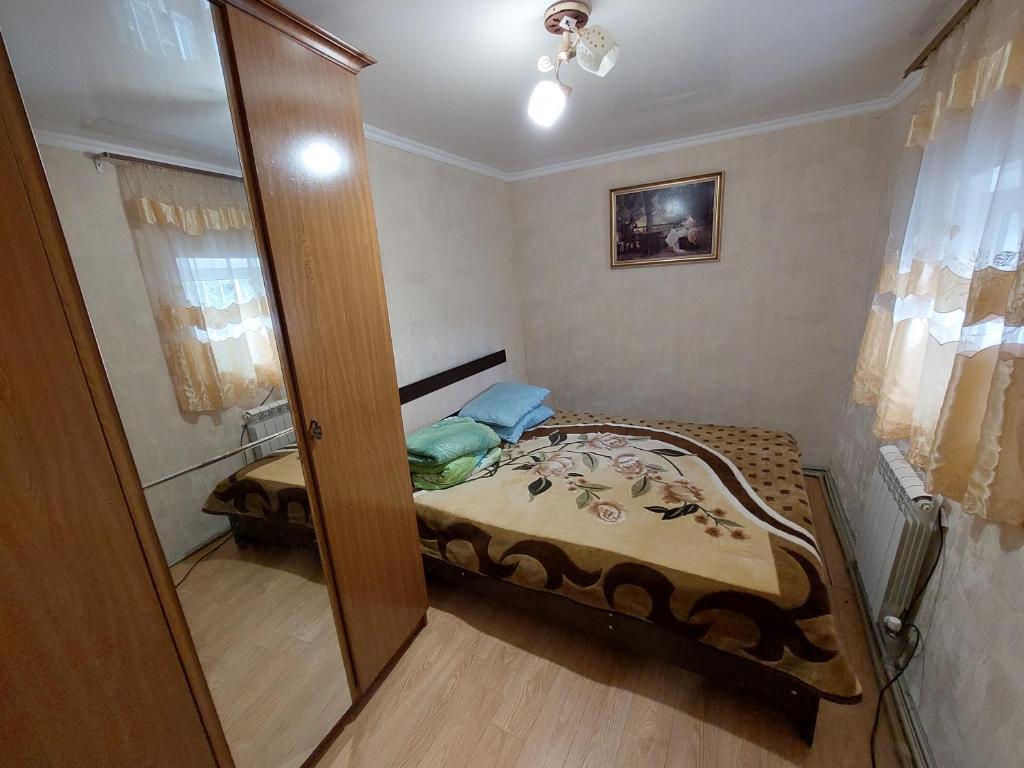 Кровать или кровати в номере Apartment on Gagarina 26