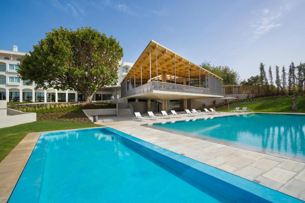The swimming pool at or near OZADI Tavira Hotel